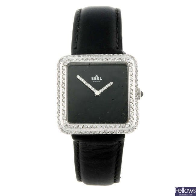 EBEL - a lady's white metal wrist watch.