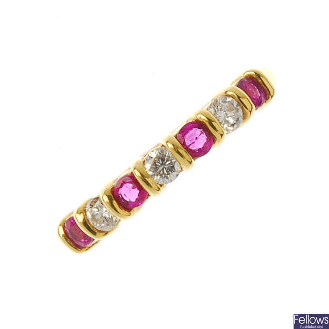 A ruby and diamond half-circle eternity ring.