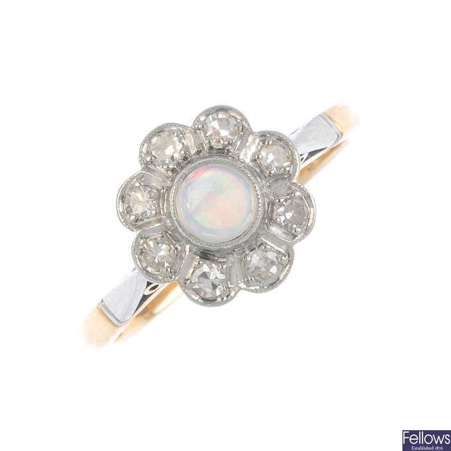 A mid 20th century platinum and 18ct gold opal and diamond cluster ring.