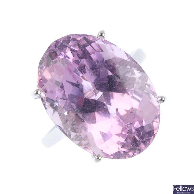A kunzite single-stone ring.
