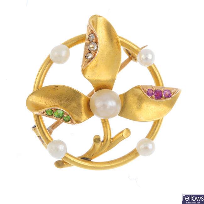 An Edwardian gold, pearl and gem-set brooch.