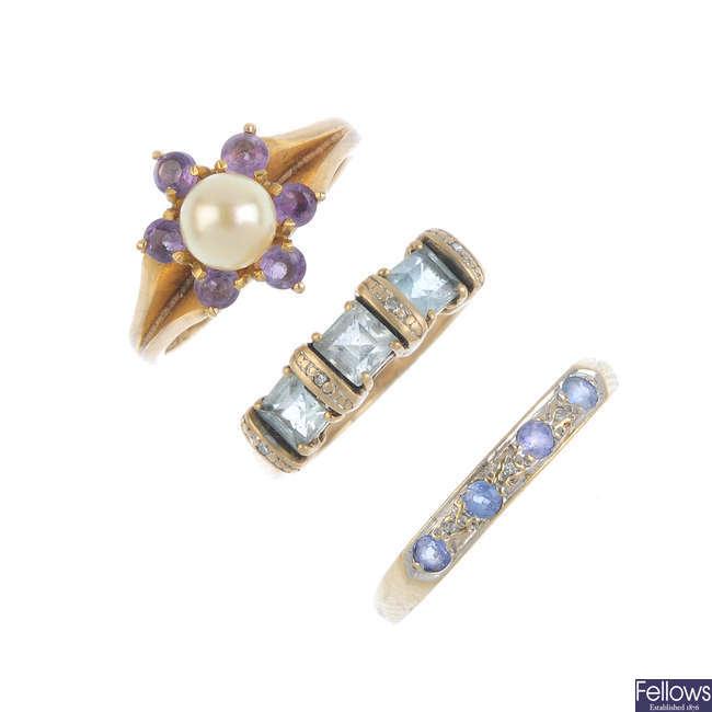 Three 9ct gold gem-set rings.