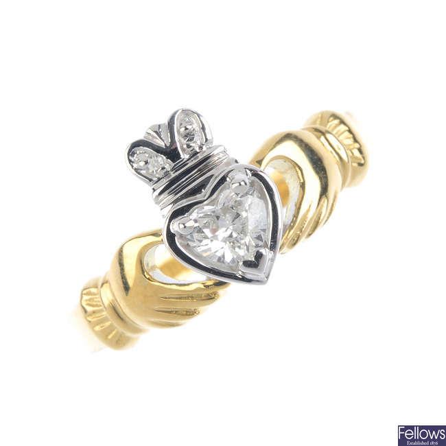 An 18ct gold diamond claddagh ring.