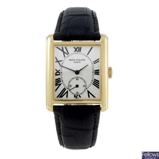 (182767) PATEK PHILIPPE - a gentleman's yellow metal Gondolo wrist watch.
