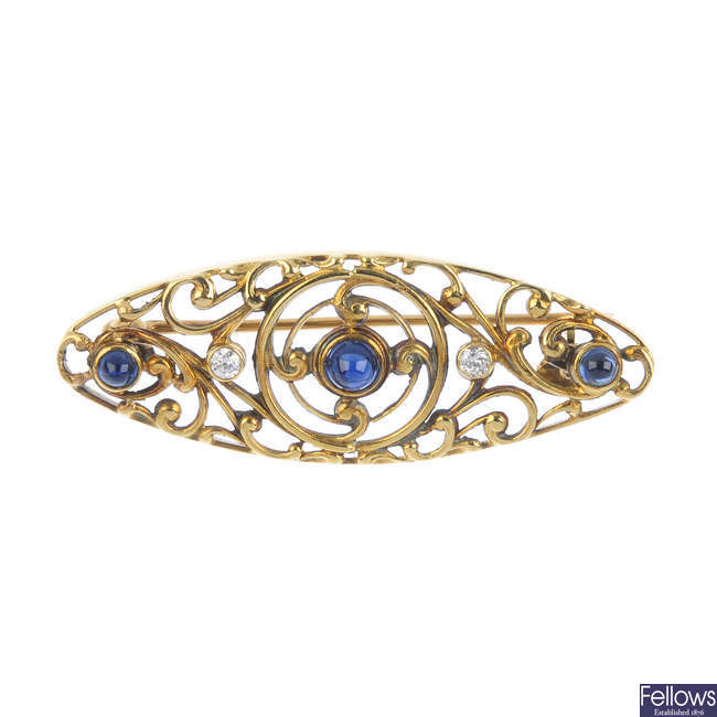 An early 20th century American 18ct gold sapphire and diamond brooch.