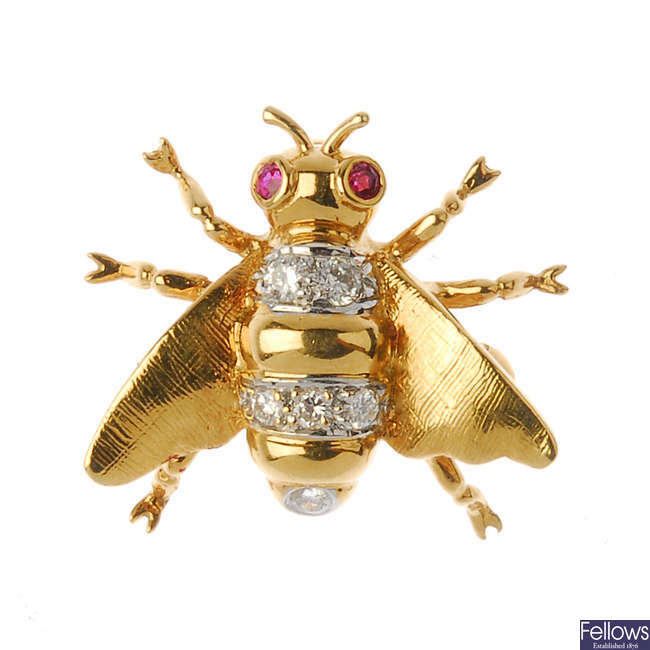 An 18ct gold diamond and ruby bee brooch.