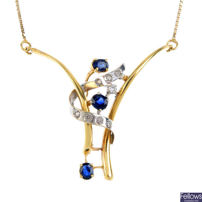 A sapphire and diamond necklace.