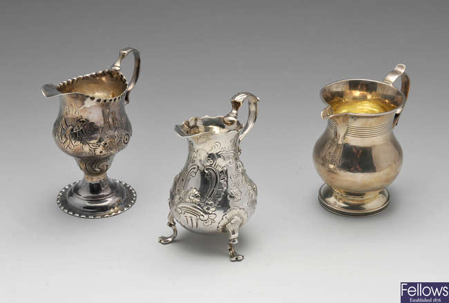 Two George III silver cream jugs, plus another William IV example.