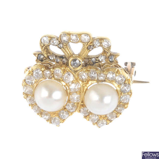 An early 20th century gold, diamond and cultured pearl brooch.