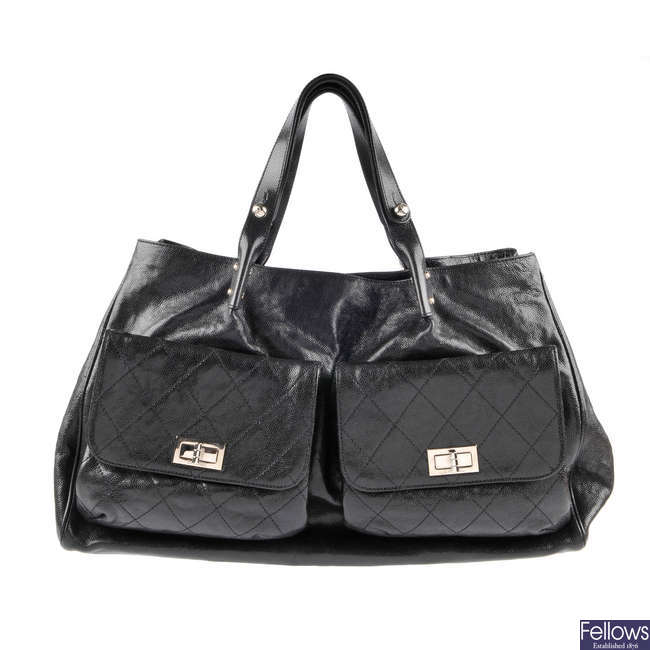 CHANEL - a black leather Pocket-in-the-City large tote handbag.