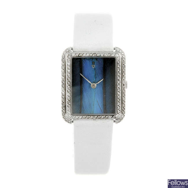 CORUM - a lady's diamond set 18ct white gold wrist watch.