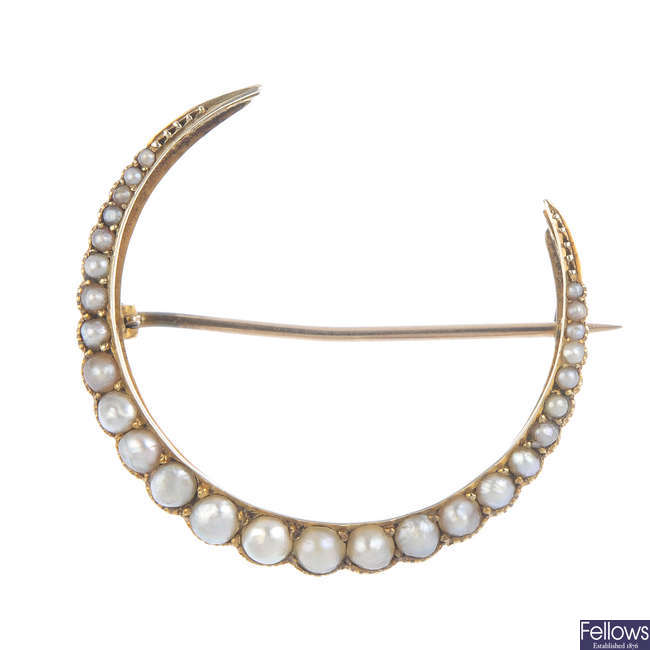 MURRLE BENNETT & CO. - an early 20th century 9ct gold split pearl crescent brooch.