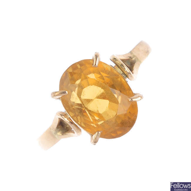 A citrine pendant and ring.