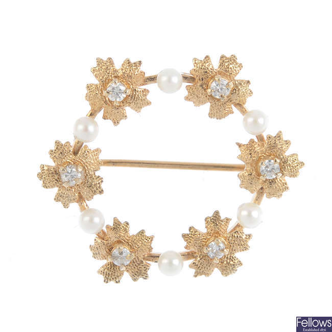 A 9ct gold diamond and cultured pearl wreath brooch.