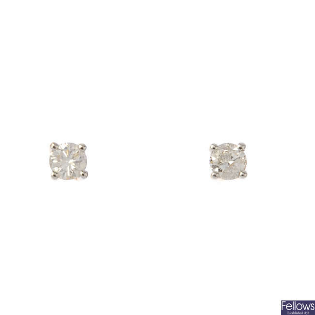 A pair of brilliant-cut diamond ear studs.