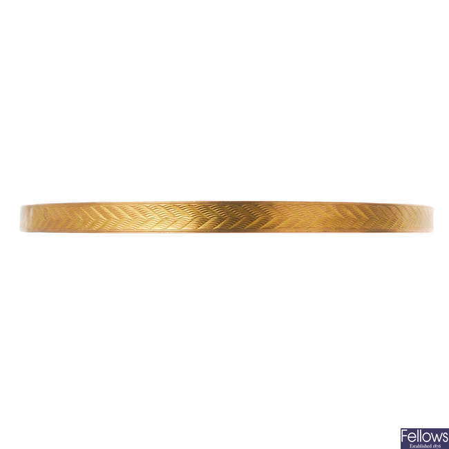 An early 20th century 9ct gold slave bangle.