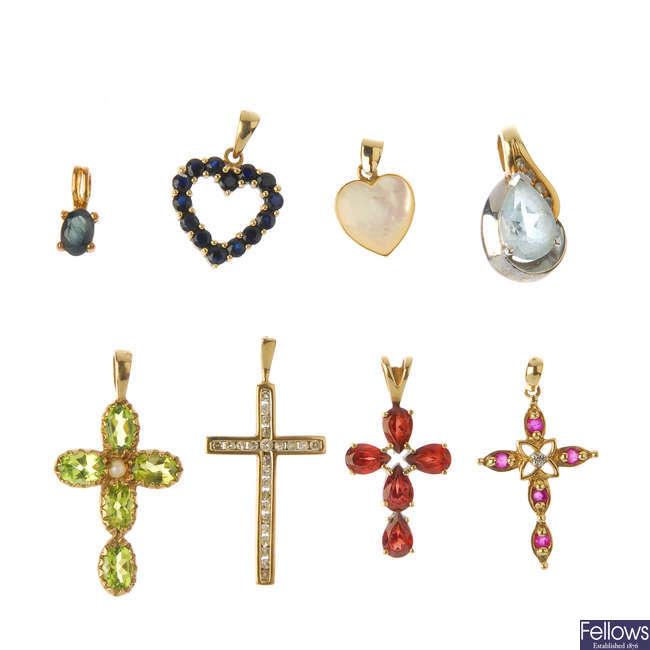 Eight gem-set and diamond pendants.