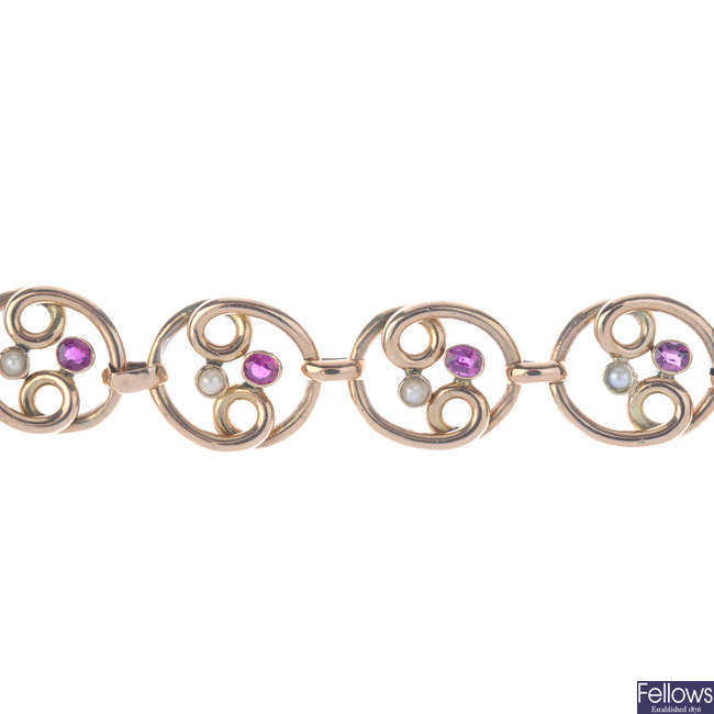 An early 20th century 9ct gold gold ruby and split pearl bracelet.