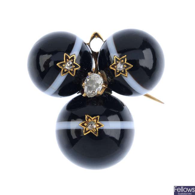 An agate and diamond brooch.