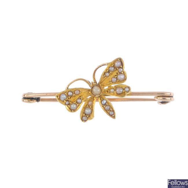 An Edwardian gold split pearl butterfly brooch.