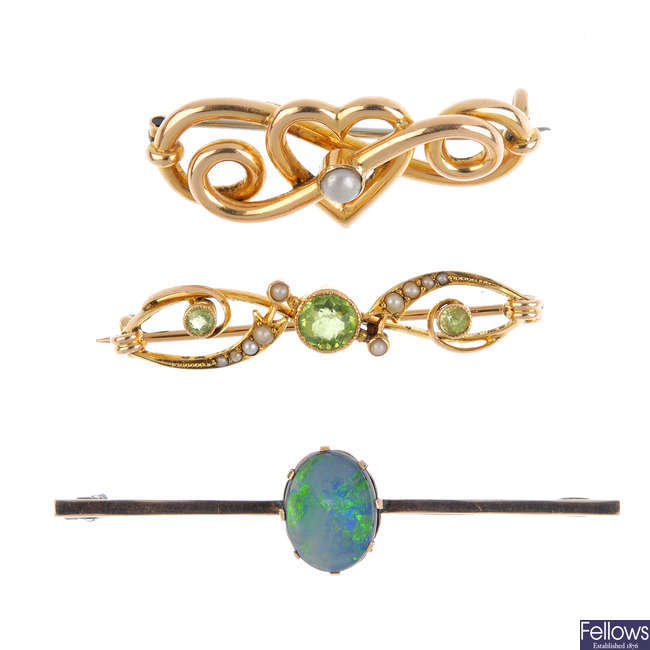 Four early 20th century gold gem-set brooches.