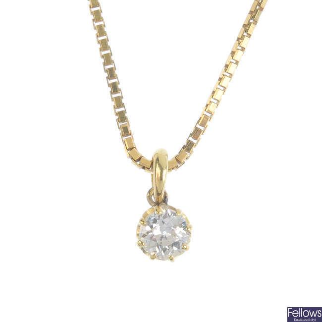 A diamond single-stone pendant, with chain.