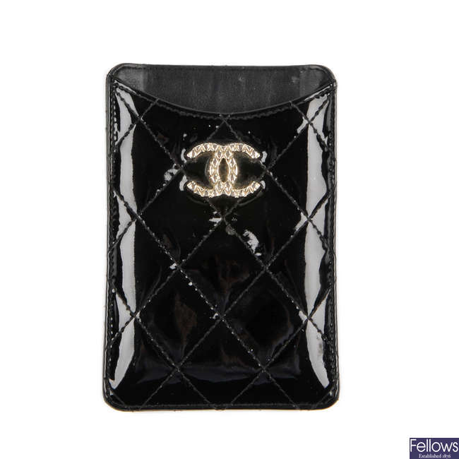 CHANEL - a quilted patent leather phone case.
