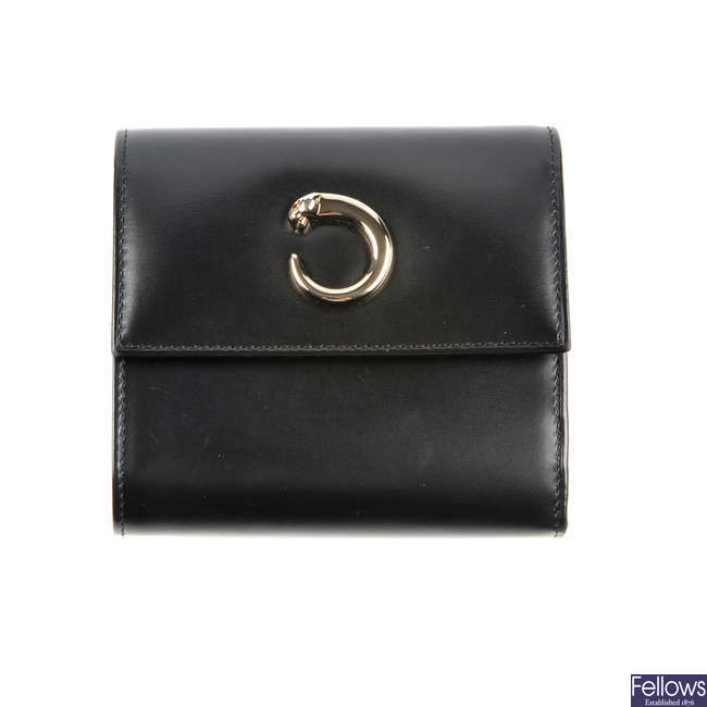 CARTIER - a black leather Panthere compact wallet.