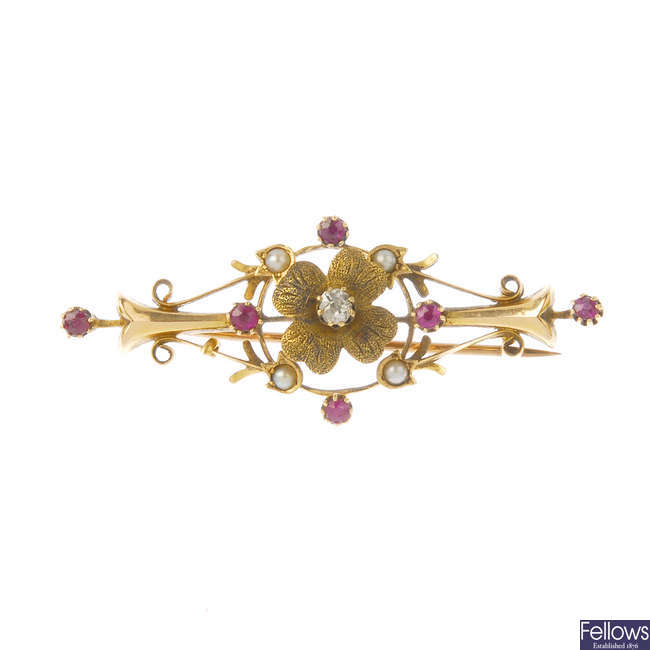 A late Victorian 15ct gold diamond, ruby and split pearl brooch, circa 1890.