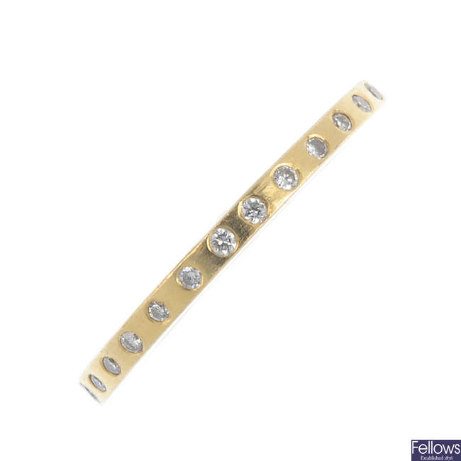 An 18ct gold diamond eternity ring.
