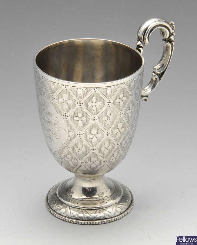 A Victorian silver mug.