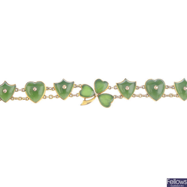 An early 20th century 9ct gold jade panel bracelet.