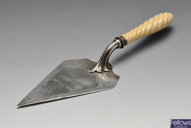 A Victorian silver presentation trowel with ivory handle.