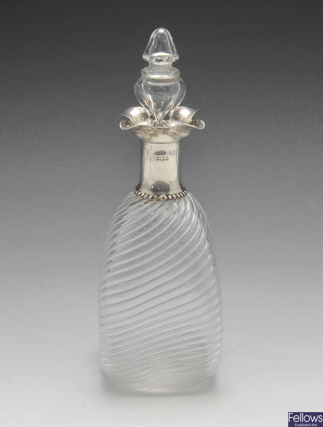A late Victorian silver mounted glass decanter and stopper.