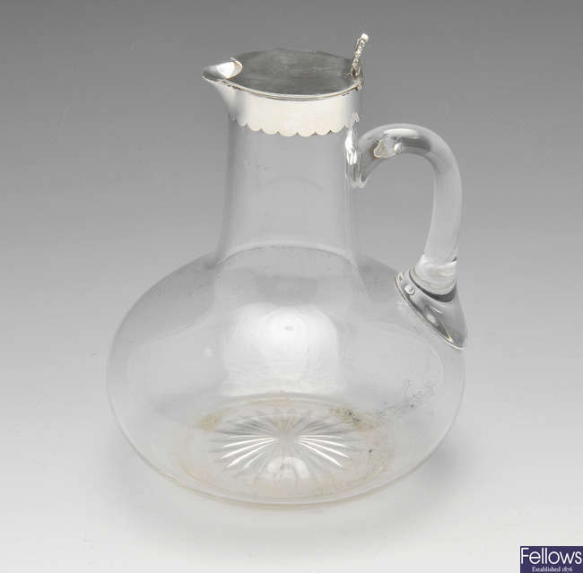 A late Victorian silver mounted clear glass claret jug.