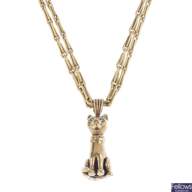A 9ct gold cat pendant, with chain.
