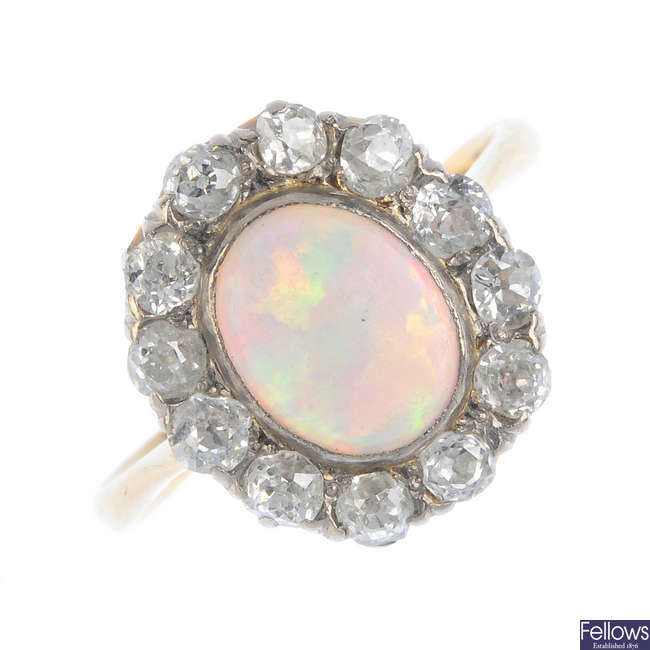 An early 20th century 18ct gold opal and diamond cluster ring.