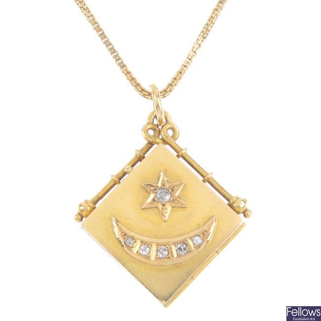 An early 20th century 18ct gold diamond hinged locket.
