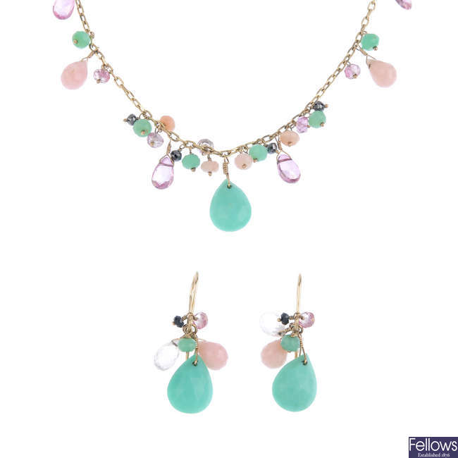 A multi-gem necklace and earrings.