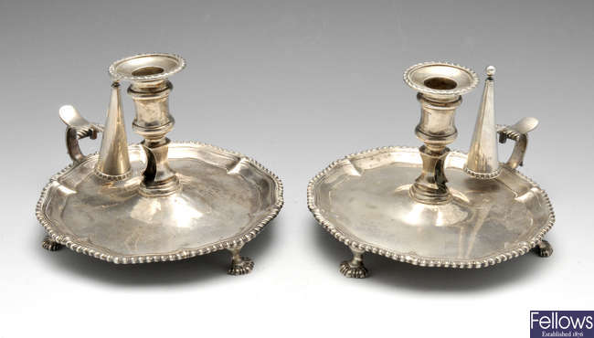 A pair of George III silver chambersticks.