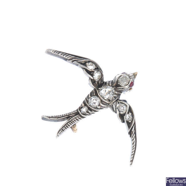 A late Victorian silver and gold, diamond swallow brooch, circa 1890.