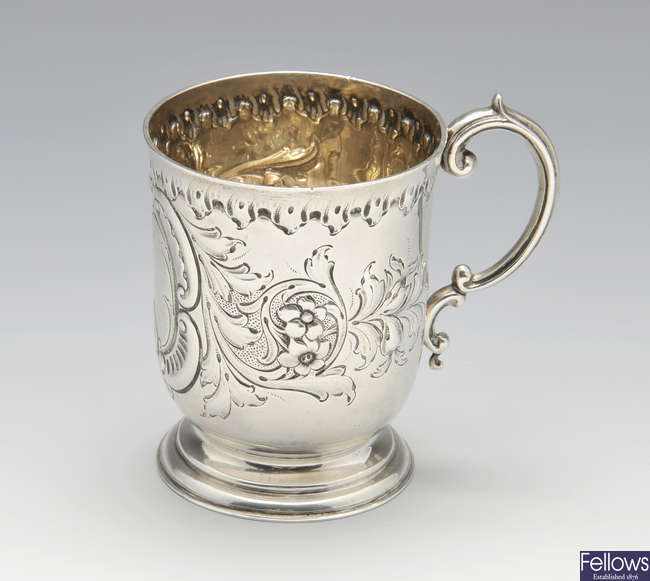 A late Victorian silver christening mug.