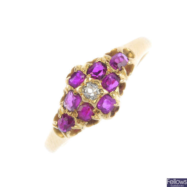 An early 20th century gold ruby and diamond cluster ring.