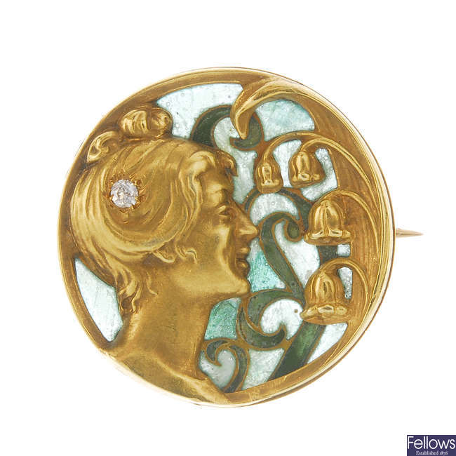 An Art Nouveau gold and enamel brooch.