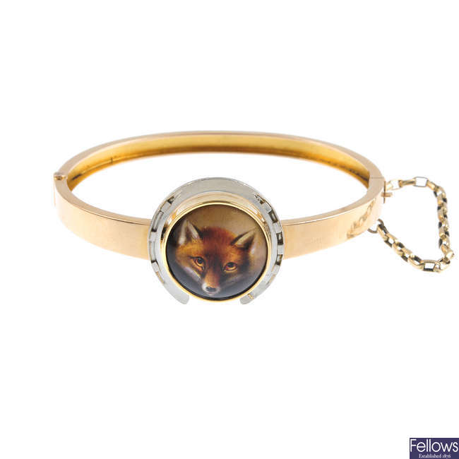 An enamel fox hinged bangle.