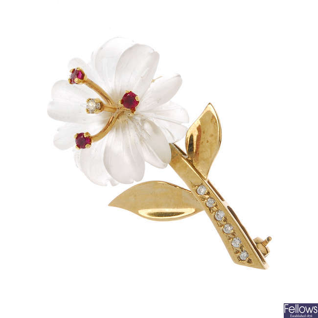 A 9ct gold rock crystal diamond and ruby floral brooch.
