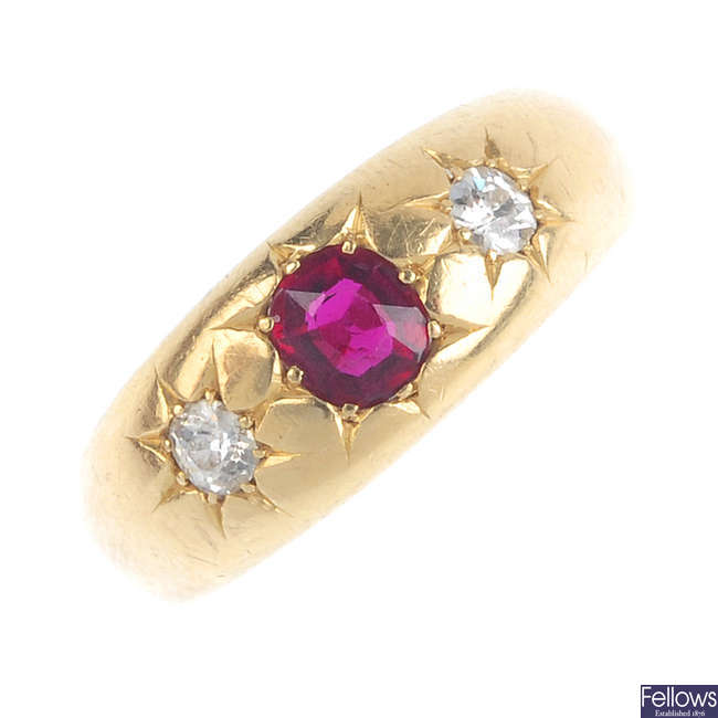 A late Victorian 18ct gold ruby and diamond three-stone ring.