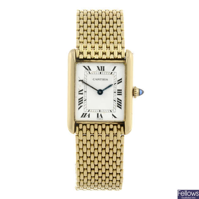CARTIER - a yellow metal Tank bracelet watch.
