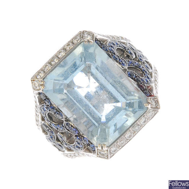 An aquamarine, sapphire and diamond dress ring.