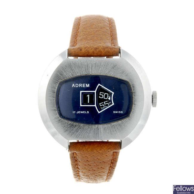 ADREM - a gentleman's nickel plated jump hour wrist watch.